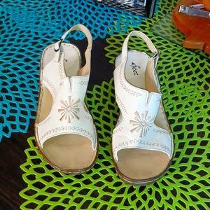 4 feet white leather sling back sandals